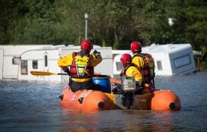Wales floods: A RNLI flood rescue team conducts a search in Aberystwyth