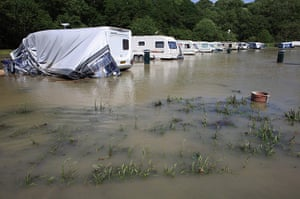 Wales floods: Caravans are damaged by flash floods near the village of Talybont