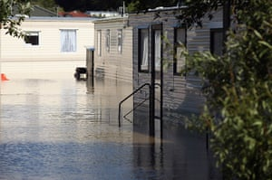 Wales floods: A caravan site is flooded in the seaside village of Borth