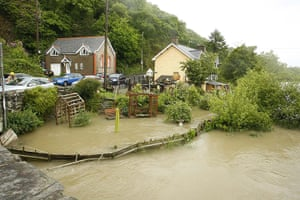 Wales floods: Flooded gardens of residential properties in Machynlleth