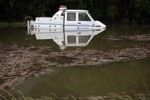 Wales floods: A breakdown truck is stranded in flood waters near Machynlleth