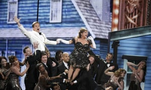 Host Neil Patrick Harris (L) performs during the American Theatre Wing's 66th annual Tony Awards