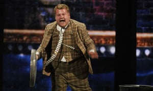 """James Corden performs in a scene from One Man, Two Guvnors""""at the 66th annual Tony Awards"""