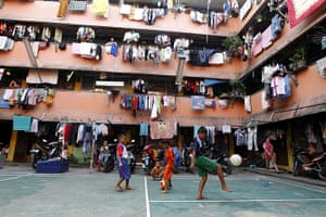 24 hours in pictures:  Indonesian boys playing soccer at a crowded flat
