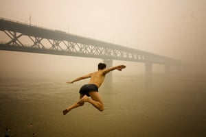24 hours in pictures: Man jumps into a river in a heavy fog in Wuhan