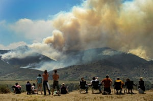 24 hours in pictures: People watch as a wildfire burns out of control in Colorado