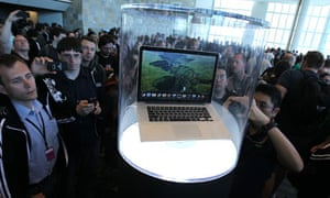 WWDC attendees checking out Apple's new MacBook Pro
