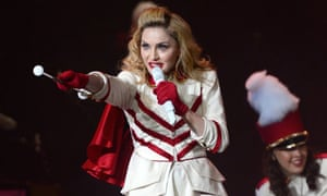 Madonna performs on stage during her MDNA tour