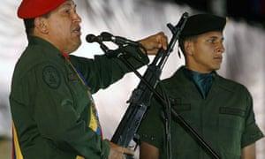 Venezuela's Hugo Chávez holds a Russian-made Kalashnikov rifle