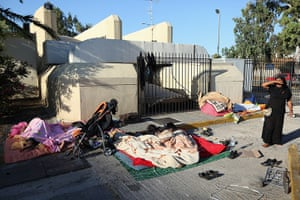 Greece: 13-14 June: Homeless people sleep on the ground at the edge of a car park in Piraeus