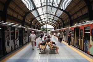 Greece: 13-14 June: Passengers wait on the platform of Piraeus station