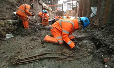 Workers excavate bones at the site of the viaduct in Borough, London