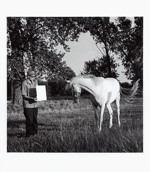 Invisible Art: A black and white image of man with horse