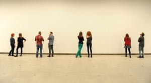 Invisible Art: A group of people look at a blank wall
