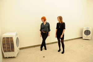 Invisible Art: Two Women in gallery space look at heater