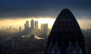 A view of 'the Gherkin and Canary Wharf at sunrise across the City of London