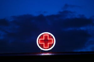 Greece: health system: A red neon cross on the Evangelismos Hospital