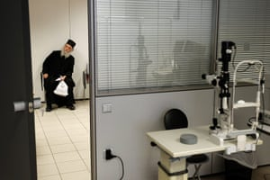 Greece: health system: An Orthodox monk waits to be examined