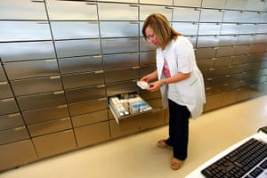 Greece: health system: Pharmacist Elina Morfopoulou checks medicines