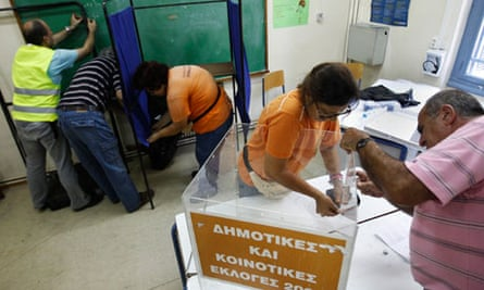 Municipality workers set up a ballot box at a voting centre in Athens