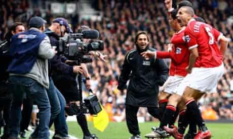 Rio Ferdinand and Cristiano Ronaldo celebrate in front of a Sky TV camera in a 2007 Man United match