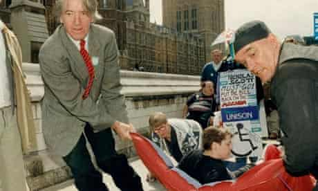 Skinner helps to drag a disabled protester into the House of Commons, 1994.