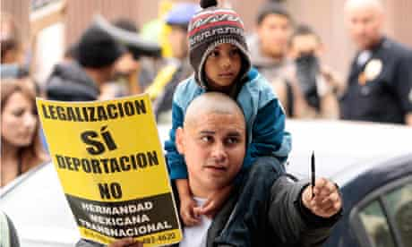 An immigration protester carries a child on his shoulders during demonstrations in Los Angeles
