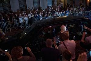 Obama fundriser NYC: Pedestrians watch Obama's motorcade
