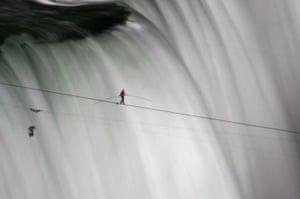 niagara falls tightrope: Nik Wallenda is a miniature figure against Niagara Falls