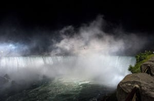 niagara falls tightrope: Nik Wallenda in the spray and mist of Niagara Falls