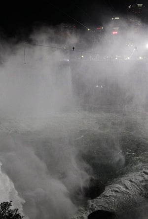 niagara falls tightrope: The tightrope walker above the roiling falls, with high-rises