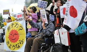 People protest in Tokyo against the Japanese prime minister's decision to restart nuclear reactors