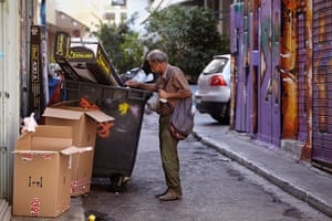Andy Hall Athens: A man looks through dustbins in Athens