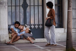 Andy Hall Athens: A homeless family rest in the street in Athens