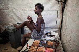 FTA Finbarr O'Reilly: Model Diarra Thiam applies make-up backstage