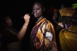 FTA Finbarr O'Reilly: A make-up artist applies final touches to a model