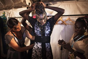 FTA Finbarr O'Reilly: Moroccan designer Jamila, left, makes adjustments to a creation