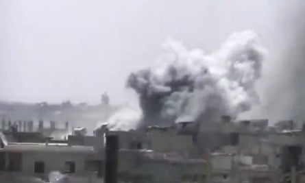 Smoke rises from buildings following a government bombardment in Rastan, Homs province