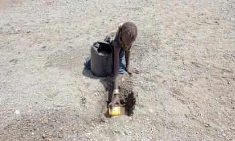 A boy from the Turkana Tribe collects water