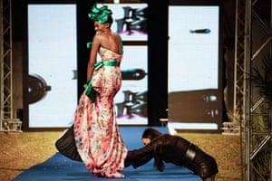 Dakar fashion week: A model reacts as her shoe on the runway
