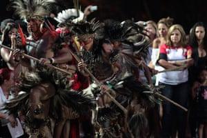 UN Rio+20: Indigenous men from Terena tribe dance at Kari-Oca village