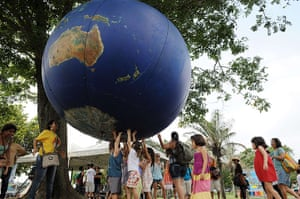 UN Rio+20: Children play with a giant globe at the People  s Summit in Flamengo park