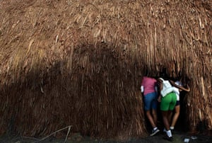 UN Rio+20: Students look inside a indigenous traditional house