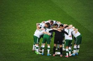 Italy fix: The Ireland team huddle before kick-off.