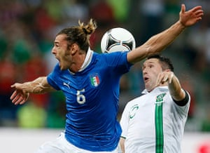 Italy fix: Robbie Keane goes up with Federico Balzaretti during the early exchanges