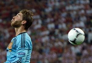 Italy fix: Spanish defender Sergio Ramos heads the