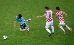 Italy fix: David Silva goes to ground after a challenge from Ognjen Vukojevic.