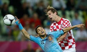 spain game: Substitute Jesus Navas is beaten to the header by  Ivan Strinic