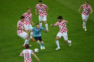 spain game: Andres Iniesta is surrounded by Croatian players