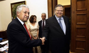 Pasok leader Evangelos Venizelos (right) shakes hands with Democratic Left leader Fotis Kouvelis